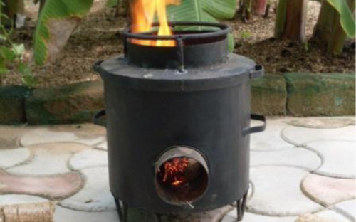 """No Trees – No Life"" of Naturefriends Gambia - alternative stoves lighted with pressed peanut shells briquettes."